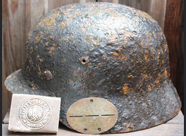 German helmet M35 with buckle and dogtag / from Novgorod