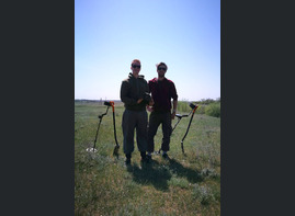 Our guests with Wehrmacht helmet in field near Stalingrad