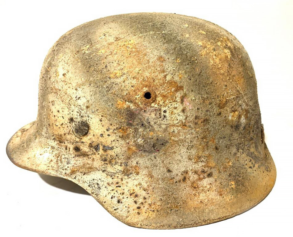 Restored German helmet M35 and canister