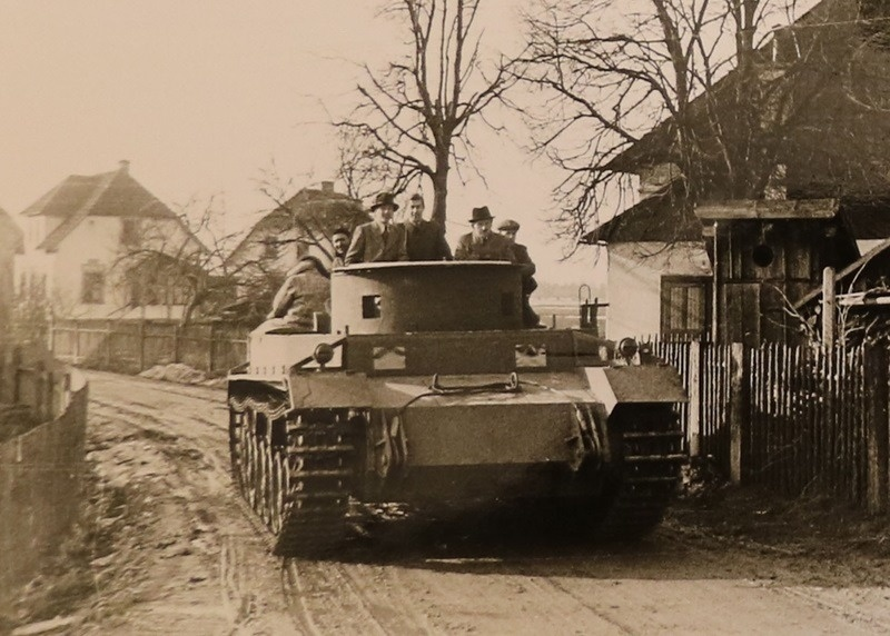 "Ferdinand Porsche in an experimental tank of his own design at the site ""Nibelungenverke"""