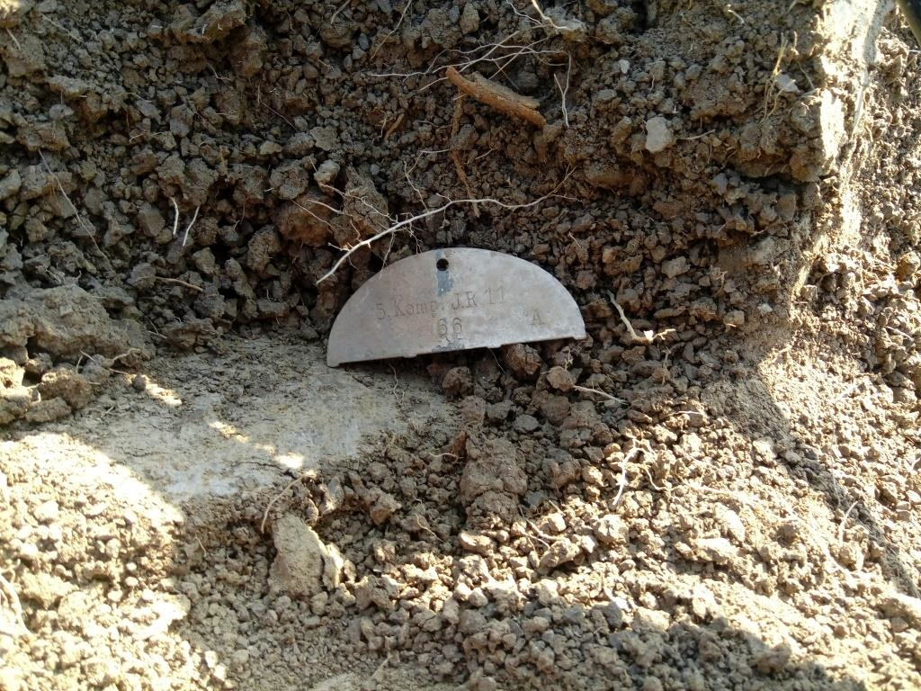 This half dog tag was found on a medical pit