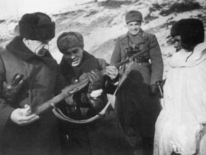 The commander of the 62nd Army Vasily Chuikov and a military council member Kuzma Gurov scrutinizing a rifle of a legendary sniper Vasily Zaytsev
